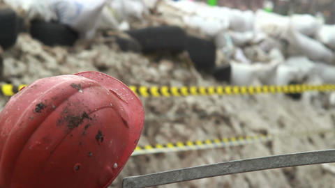 Construction hard hat barricades of snow tyres barbed wires Footage