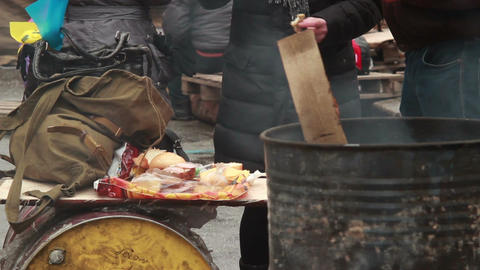 Smoking barrel people eating meal winter outdoors, poor have-not Footage