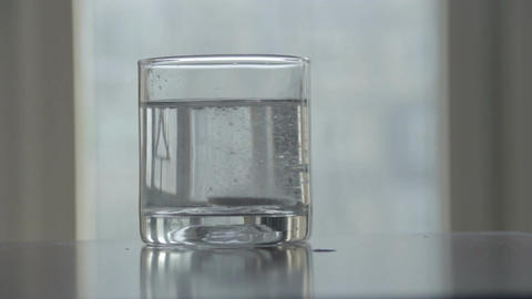 Dissolving effervescent tablet in clean glass of water, sound Footage