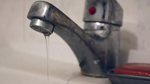 Turning running flowing water off, closing bathroom tap Footage