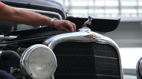 Dodge DR Special, 1934, repair man adding water, screws bolts Footage