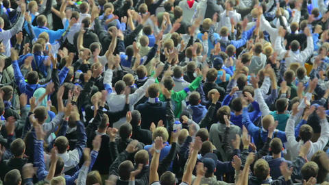 Multiple claps hands in the air football supporters stadium game Footage