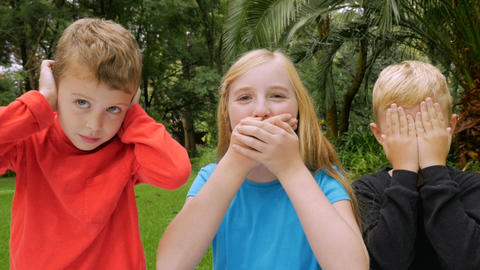 Three adorable young children play out see no evil, hear no evil, speak no evil Footage