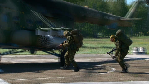 Russian armed soldiers ran to the helicopter Live Action
