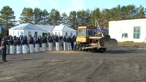 Militarized Police with tractor in prison riot are waiting Footage