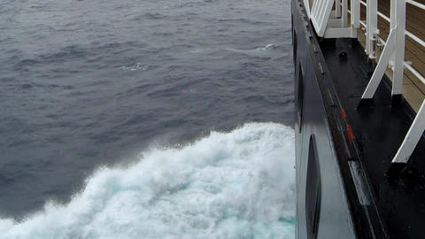 Large cruise ship at open sea. Waves splashing on the side of ship Live Action