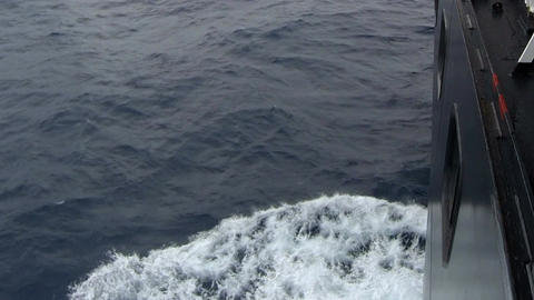 Large cruise ship at open sea. Waves splashing on the side of ship Footage