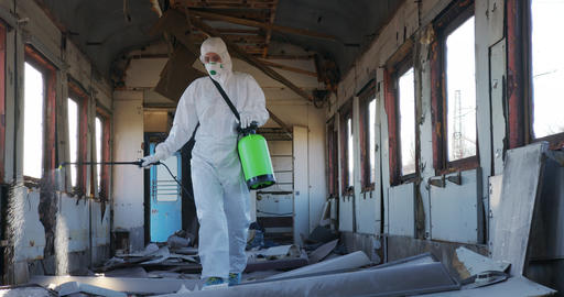Disinfection against virus. Doctor virologist in protective suit sprays medicine Live Action