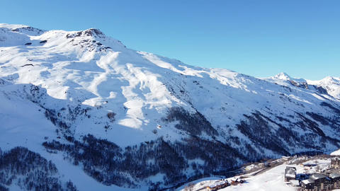 Aerial view of the Alps mountains in France. Mountain tops covered in snow Live Action
