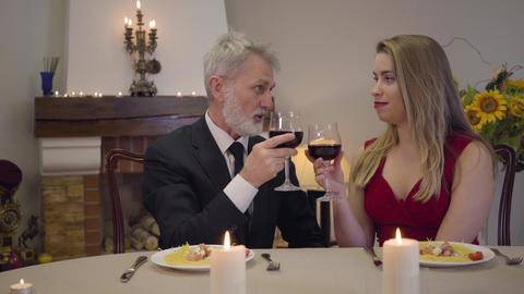 Romantic evening of Caucasian couple with age difference. Young beautiful woman Live Action
