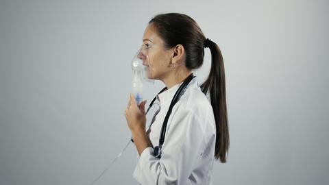 Female doctor demonstrates nebulizer works Live Action