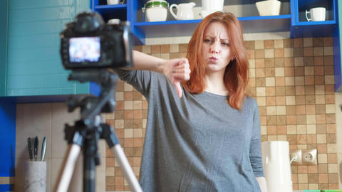 Food blogger girl influencer is recording a video or podcast in the kitchen Live Action