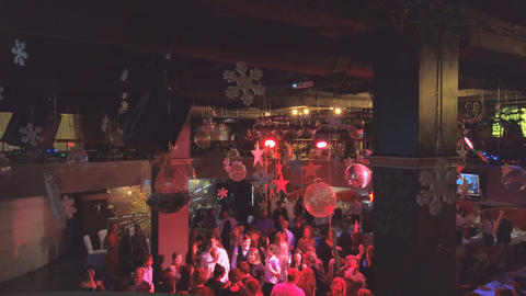 People dance at a party in a nightclub or restaurant. Corporate party Live Action