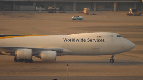 Airfreighter taxiing near cargo terminal Live Action
