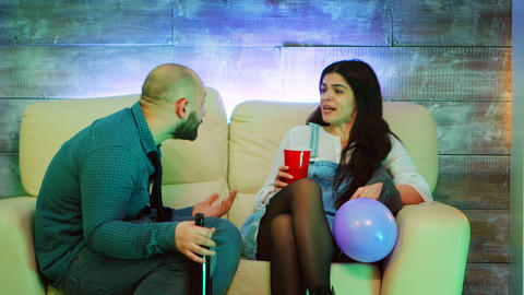 Young couple having a conflict at one of theirs best friends party Live Action