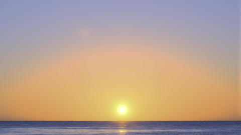Sunrise over the sea. Orange color of sunrise and waves. Yellow hot sky over the Live Action