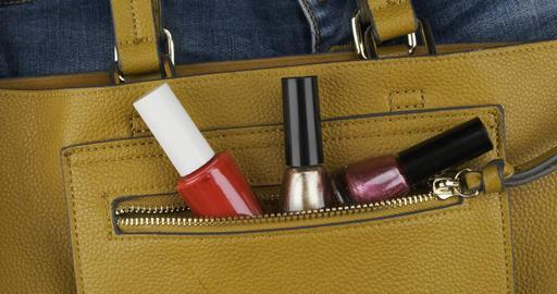 Nail polish sticks out of a pocket of a woman's bag. Panorama. Top view ライブ動画