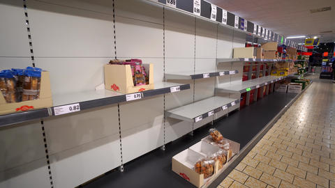 Granada Spain 14 March , 2020: Empty supermarket shelves. Panic from the Live Action