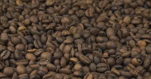 Close-up, wavy background of coffee beans. Copy space Live Action