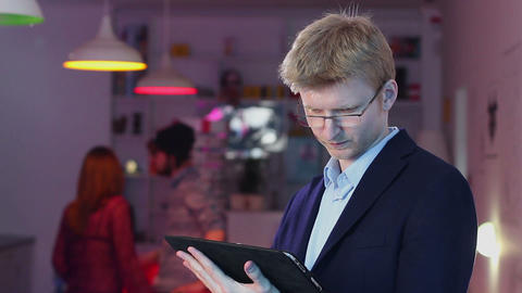 Businessman in glasses, hotel cafe restaurant business reading Footage