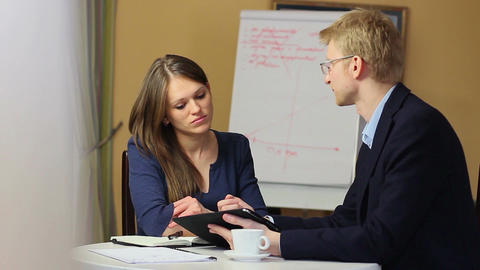 Businessman explaining problem business woman makes notes in pad Footage