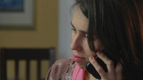 Close-up sad single woman talks phone, breaking relationships Footage