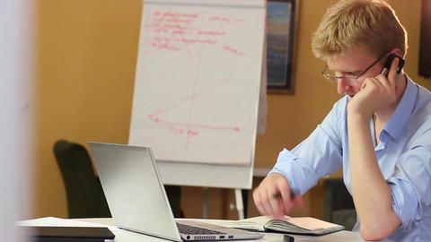 Business conversation over phone, man talks writes data, smiles Footage