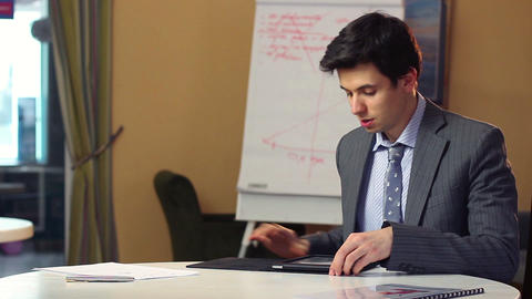 Business man opens tablet PC news reading, dark hair, suit Footage