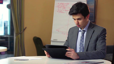 Business man reading news on tablet PC, financial updates index Footage