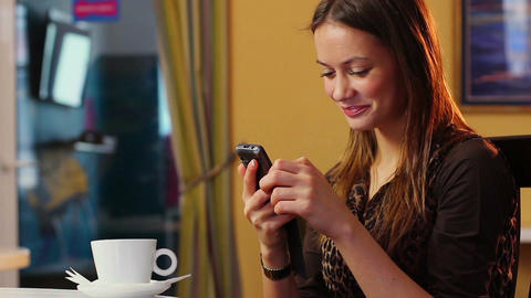 Cheerful young lady received phone message from friend, smiles Footage