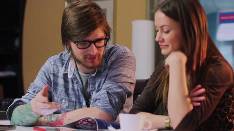 Young man woman couple on date chatting reading magazine... Stock Video Footage