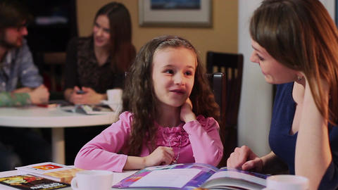 Happy little daughter talks excited mother caf?, couple chatting Footage
