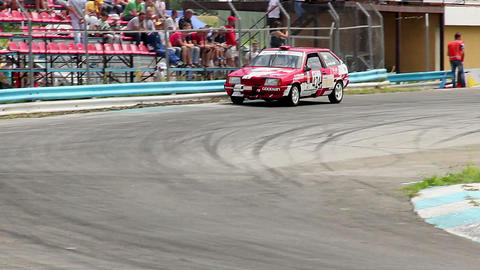 Car race competitors drifting in hot pursuit, turning sharp turn Live Action