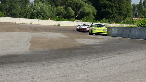 Racing autos taking turn during tournament, hot pursuit on track Live Action