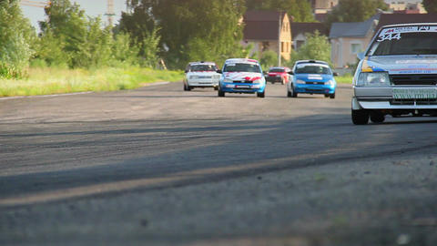 Group of racing cars rushing in hot pursuit on track Live Action