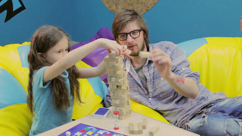 Brother helping sister build tower, playing, teaching, teamwork Footage