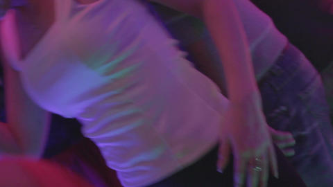 Young beautiful female enjoying nightlife, dancing to the music Live Action