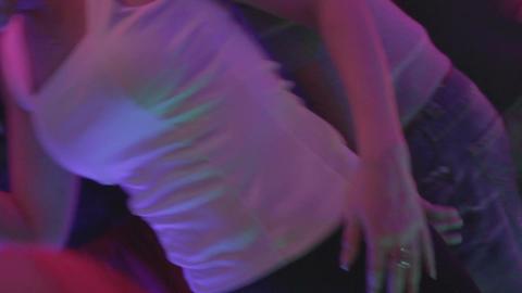 Young beautiful female enjoying nightlife, dancing to the music Footage