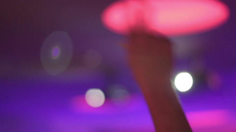 Clubber waving hands listening to music, party in nightclub Footage