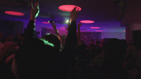 Dance floor in the nightclub, young men women partying, drinking Footage