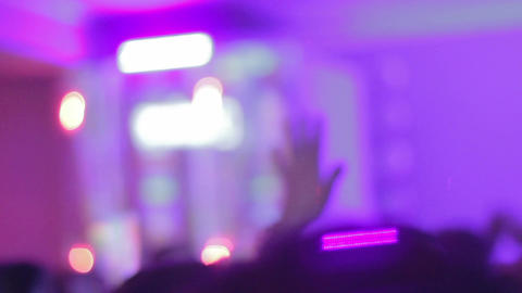 Young people waving hands to sound of music in nightclub Footage