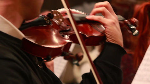 Male performs lead violin sole part playing at classical concert Footage