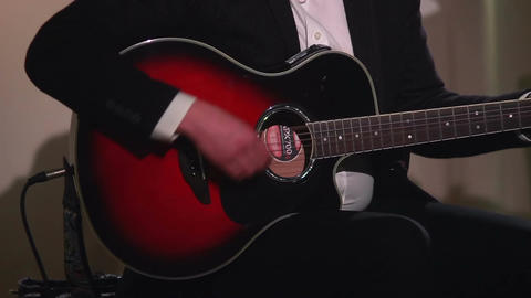 Guitar playing man, musical concert performance, red classical Footage