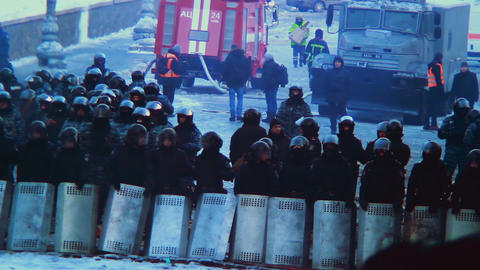Street riot Special Forces shields helmets against crowd winter Footage