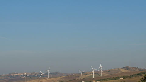 Wind turbines ratating farm on high hill, green clean energy eco technology 4k Live Action