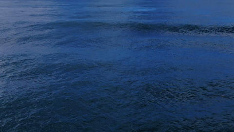 Splashing sea waves on deep blue ocean water surface,natural fluid motion 4k Live Action
