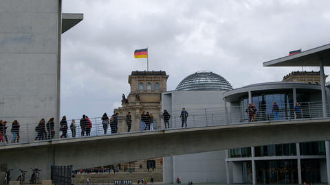 Berlin,school trip students people walk on bridge and take pictures to reichstag Live Action