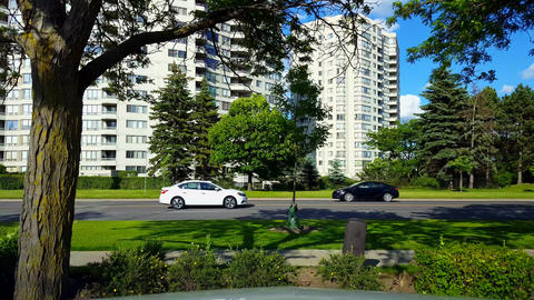 *Reverse Motion* Side View of City Traffic Driving By Lush Green Trees Backward. Fast Speed Motion Live Action