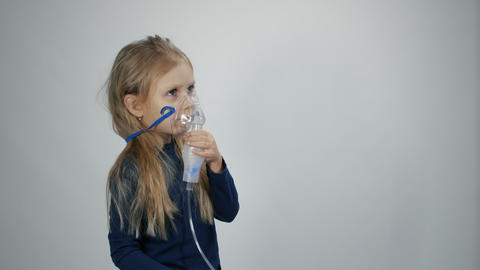 Little girl breathe with nebulizer Live Action