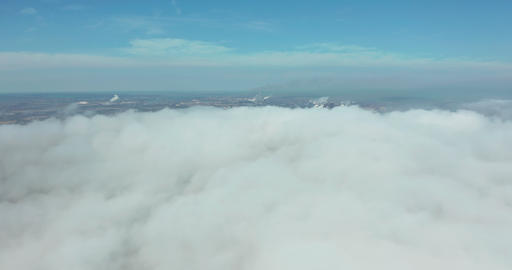 Flying in the clouds flying in the clouds. The clouds are moving on camera Live Action